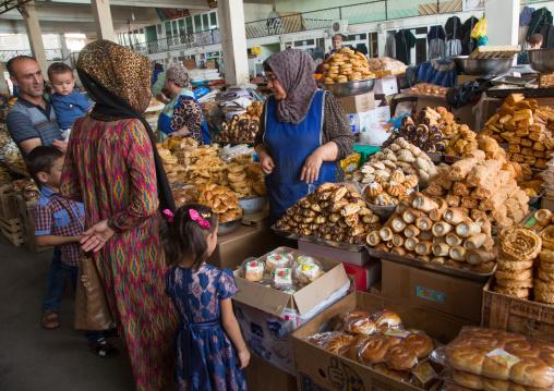 Tajik women selling cakes in a local market, Gorno-Badakhshan autonomous region, Khorog, Tajikistan
