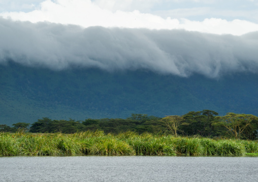 Tanzania, Arusha Region, Ngorongoro Conservation Area, clouds over landscape and mountain range