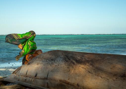 Tanzania, Zanzibar, Kizimkazi, veiled muslim woman looking away at the sea