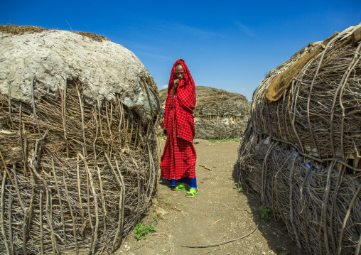Tanzania, Ashura region, Ngorongoro Conservation Area, maasai woman outside her home