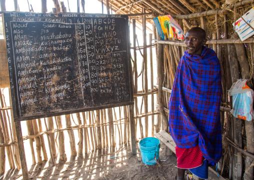 Tanzania, Ashura region, Ngorongoro Conservation Area, maasai teacher inside a school