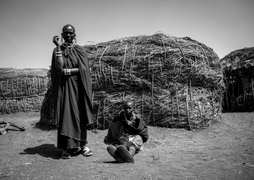 Tanzania, Ashura region, Ngorongoro Conservation Area, maasai women outside their home
