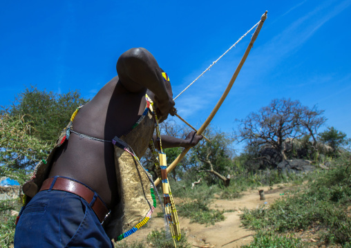 Tanzania, Serengeti Plateau, Lake Eyasi, hadzabe man with bow and arrow
