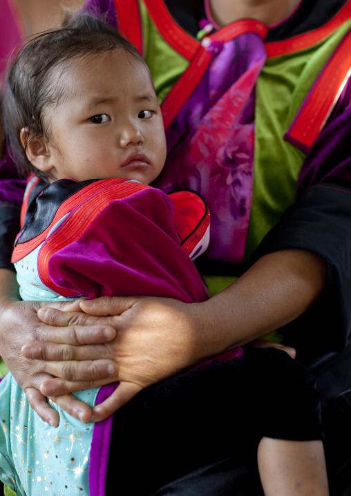 Baby with her mother in ban nam rin village, Lisu tribe, Thailand