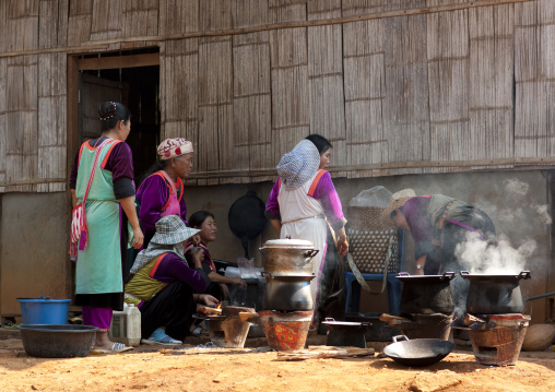 Lisu tribe women making food in ban nam rin village, Thailand