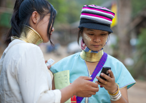 Long neck women using a phone, Mae hong son, Thailand