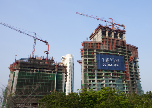 Cranes near skyscrapers, Bangkok, Thailand