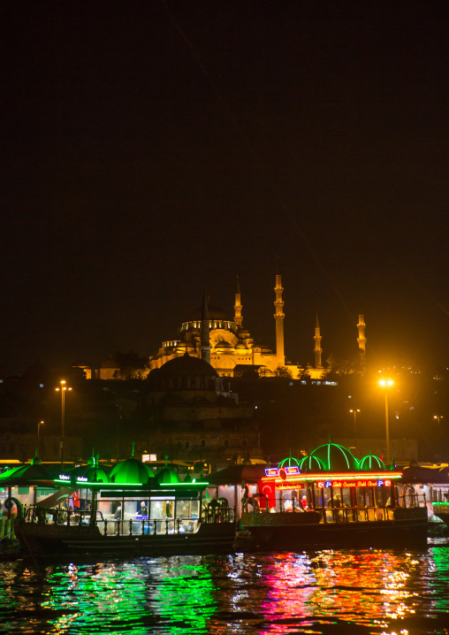 Galata bridge restaurants with Suleymaniye mosque in the back at night, Marmara Region, istanbul, Turkey