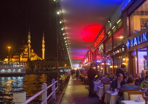 Restaurants under Galata bridge at night, Galata, istanbul, Turkey