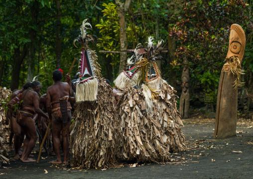 Rom dance masks and giant slit drum during a ceremony, Ambrym island, Fanla, Vanuatu