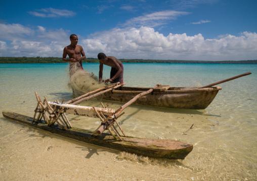 Young boys of the Ni-Vanuatu people with their dugout, Sanma Province, Espiritu Santo, Vanuatu