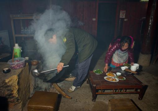Couple cooking in their kitchen, Sapa, Vietnam
