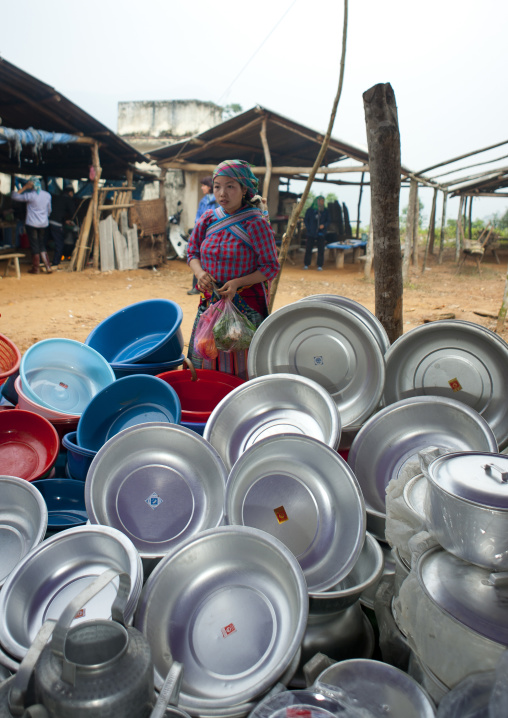Woman looking at bowls at sapa market, Vietnam