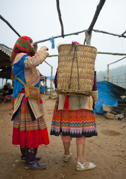Flower hmong women with a basket at sapa market, Vietnam