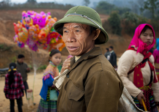 Man with a colonial hat on a market place, Sapa, Vietnam