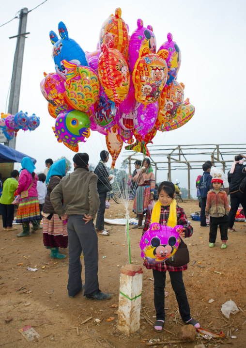 Girl selling balloons on a marketplace, Sapa, Vietnam