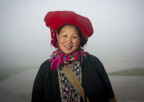 Smiling red dzao woman with traditional headgear, Sapa, Vietnam