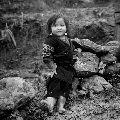 Cute young black hmong girl in traditional clothes, Sapa, Vietnam