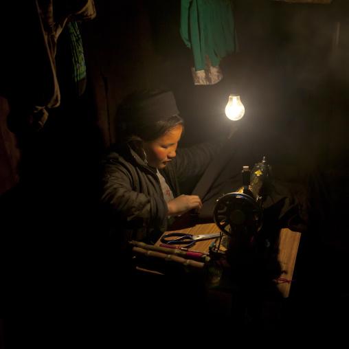 Black hmong girl on a sewing machine, Sapa, Vietnam