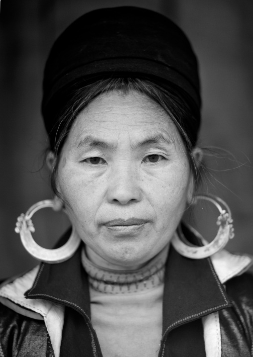 Black hmong woman with traditional headgear and earrings, Sapa, Vietnam