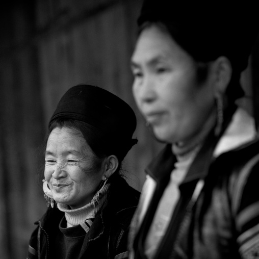 Black hmong women with traditional hat and earrings, Sapa, Vietnam