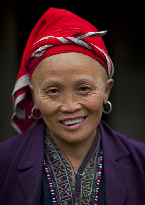 Old red dzao woman with a red headscarf, Sapa, Vietnam