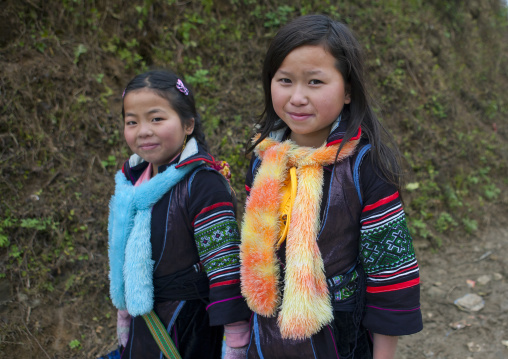 Black hmong girls wearing traditional scarves, Sapa, Vietnam