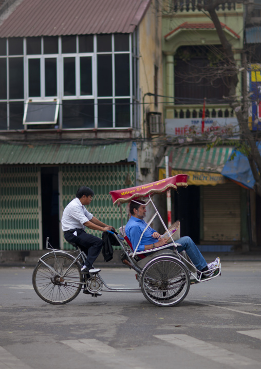 Men on a rickshaw in hanoi, Vietnam