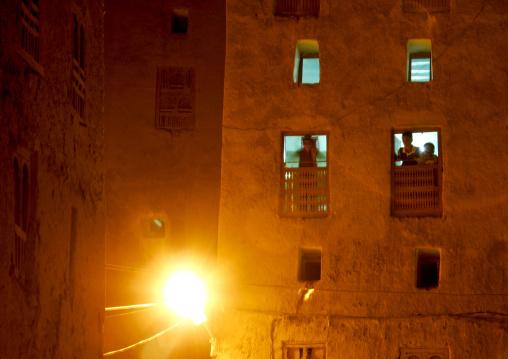 Children Showing Up At The Windows At Night, Shibam, Yemen