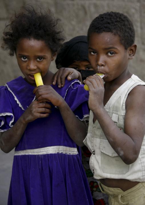 Black Amran Kids Eating Stick Popsicle, Amran, Yemen