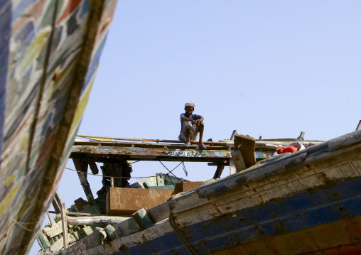 Young Man Sitting On The Top Of A Dhow, Al Hodeidah Harbour, Yemen