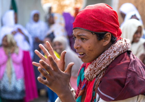 Harari woman goes into a trance during a muslim ceremony, Harari Region, Harar, Ethiopia