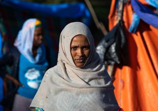 Veiled oromo woman in a market, Amhara region, Senbete, Ethiopia