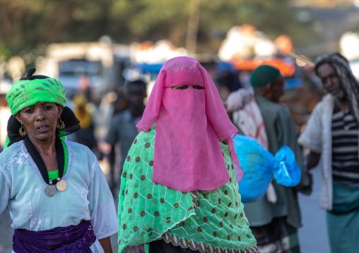 Oromo woman wearing a pink burqa in the market, Amhara region, Senbete, Ethiopia