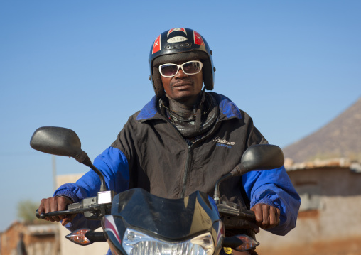 Himba With A Helmet And Sunglasses On A Motorbike, Village Of Oncocua, Angola
