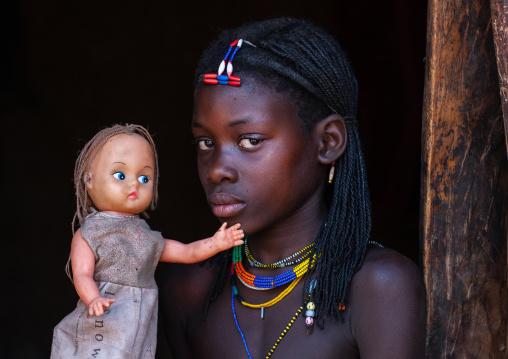 Muhacaona tribe girl with a western doll, Cunene Province, Oncocua, Angola
