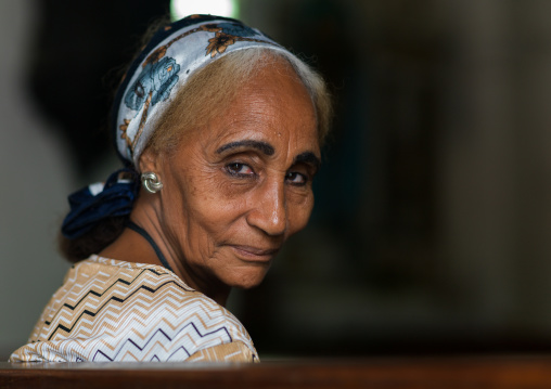 Old woman in a church, Benguela Province, Benguela, Angola
