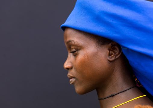 Mucubal tribe woman wearing a blue headwear, Namibe Province, Virei, Angola