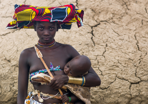 Mucubal tribe young woman with her baby, Namibe Province, Virei, Angola