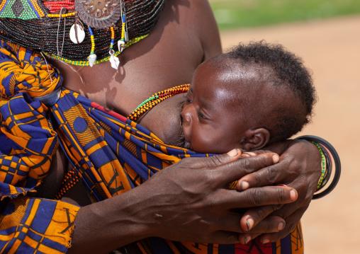 Mumuhuila tribe mother breastfeeding her baby, Huila Province, Chibia, Angola