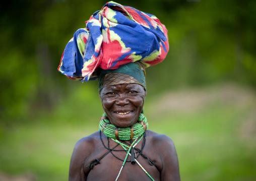 Old Mugambue Woman  Carrying A Bundle On Her Head, Angola