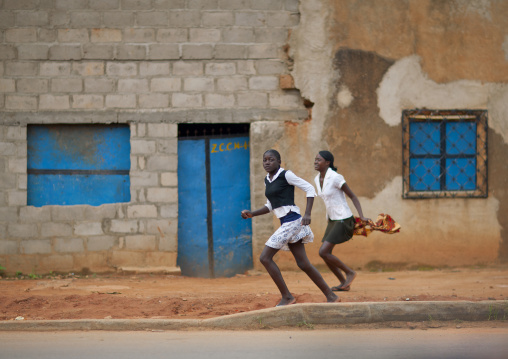 Girls Running In The Streets Of Huambo, Angola