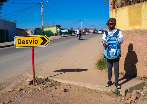 Angolan girl in the street going to school, Huila Province, Lubango, Angola