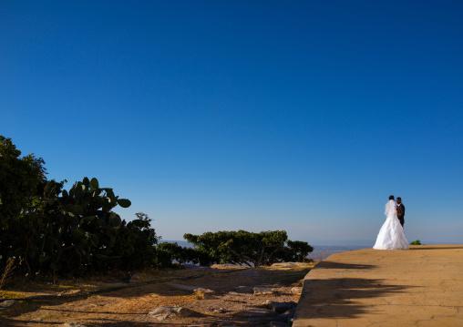 Newly wed couple overlooking the city, Huila Province, Lubango, Angola