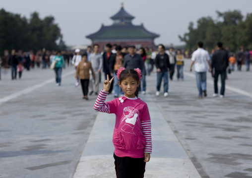Girl Saluting In Front Of Temple Of Heaven, Beijing, China
