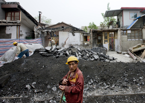 Manual Worker On A Demolition Site, Beijing, China
