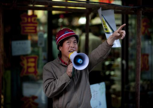 Seller Shouting In A Loudspeaker, Beijing China