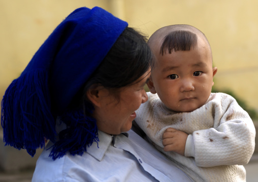 Baby With A Chinese Haricut With His Mother, Yuanyang, Yunnan Province, China
