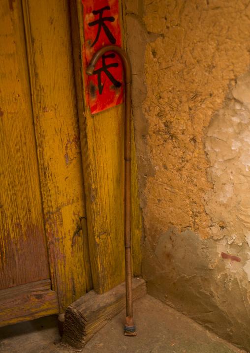 Cane At The Entrance Of A House, Tong Hai, Yunnan Province, China