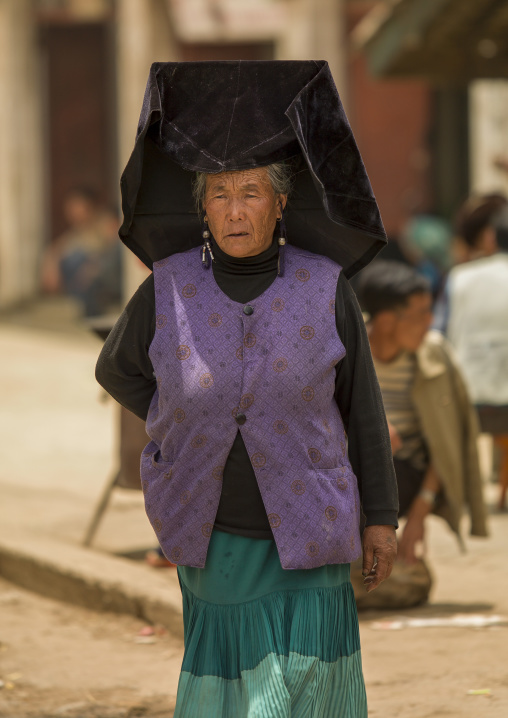 Yi Tribal Woman In Traditional Clothes, Yongning, Yunnan Province, China